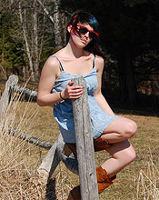 Sabrina Wearing A Cute Blue Dress And Cowboy Boots Outside - Picture 2
