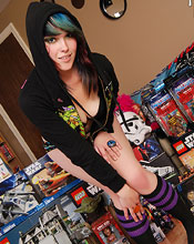 Sabrina Plops Down Amidst A Sea Of Action Figures And Other Awesome Toys For This Unique Set That Shows Off A Bit Of Her Geeky Side - Picture 9